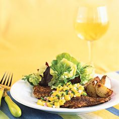 Blackened yellowtail snapper with mango salsa - the perfect mix of sweet and spicy!
