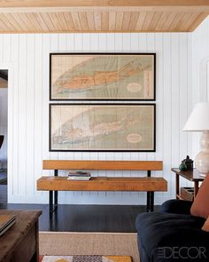 MAPS AS INEXPENSIVE WALL ART - To add some local charm to the crisp white walls of his East Hampton house, interior designer Robert Stilin hung a pair of vintage Long Island maps, purchased from Nellie's of Amagansett, above an oak-and-metal bench from R. E. Steele Antiques.