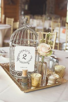 Vintage Wedding Centerpieces - Love the Birdcage. Exclusively Bridal, 20 Market Brae Steps, Inverness. www.exclusivelybridal.com