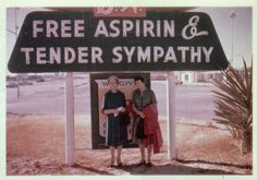 Vintage color snapshot 1950s two old ladies standing beneath free aspirin tender sympathy neon sign ~ Awkwardly Funny Family Photos