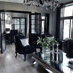 Lavish, glamorous, light grey, black, and silver home interior.