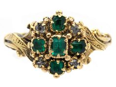 Georgian cluster ring set with emeralds and diamonds, circa 1820