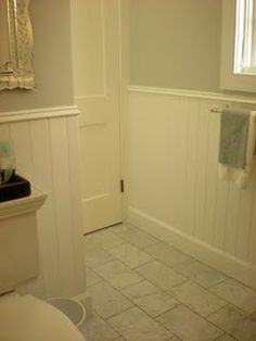 Love the tile, wall color and bead board in this bathroom.