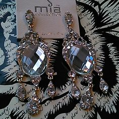 I just added this to my closet on Poshmark: Dazzling Rhinestone earringsNWT. Price: $15 Size: OS