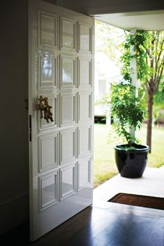 The brass front door handle was custom-made by Melbourne artist Suzie Stanford.
