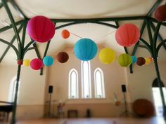 If you want to give your bedroom an Eastern feel, use hanging paper lanterns to light the room. Paper lanterns in bedroom give off a soft, colorful glow