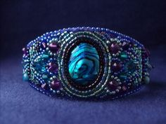 Salome's Cuff Bead Embroidered Bracelet--Luxury Bead Embroidery by CircesHouse, with Amethyst, Swarovski Crystals. $92.00, via Etsy.