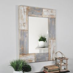 high and 24 in. wide, the Mason Planks Mirror by Firstime gives off a rustic farmhouse look. The solid wood frame alternates between aged white finished and distressed gray finished planks. The Mason Planks Mirror includes hanging h Grey Wall Mirrors, Farmhouse Wall Mirrors, Mirror Wall Clock, Window Mirror, Pallet Mirror Frame, Framed Mirrors, Round Mirrors, Wood Plank Walls, Wood Planks