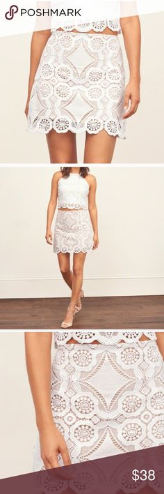 ABERCROMBIE & FITCH LACE A-LINE SKIRT Beautiful and classy! NWT! An on trend A-line skirt with sheer lace overlay, scalloped hem, zip closure, slim fit. 100% polyester, lining: 100% viscose. Size: 10, color: white. No trades, offers welcome. 0172228500 Abercrombie & Fitch Skirts Mini