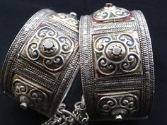 Africa | Pair of old Berber bracelets.  Khenifra. Morocco | Silver, red and blue enamel | ca. Early 20th century | 1,299$
