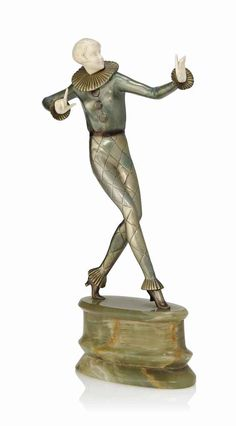 A JOSEF LORENZL ART DECO BRONZE AND IVORY FIGURE CIRCA 1930 Modelled, cast and carved as a young woman wearing a harlequin suit, onyx plinth.