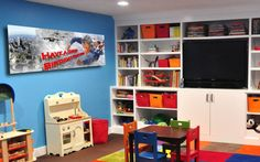 Interesting Kids Playroom Design Ideas: Patchwork Rug Of Bright Multicolored Squares Built In Storage And Flatscreen TV Kids Playroom Furniture, Playroom Organization, Furniture Ideas, Furniture Design, Organizing, Organization Ideas, Bedroom Furniture, Playroom Design, Playroom Decor