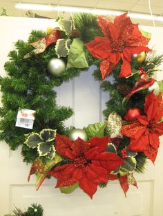 Poinsettia Wreath From the Traditions Theme at Your Christmas Shop at Stauffers of Kissel Hill Garden Centers. (http://www.skh.com/home-garden/departments-2/the-christmas-shop/)