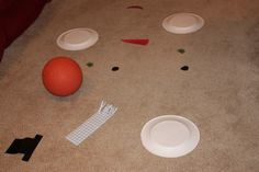 snowball roll is a gross motor game for practicing ball skills, body control and hand eye coordination.  #preschoolactivity #snowman #winter