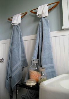 This is a really cute idea too! Inverted Wooden Hangers as Towel Bar & Hook - DIY
