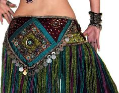 """Our decadent brocade fringe belts are beautifully embellished with metal zardosi designs, silver coin medallions, chain trim, and sparkling glass stones. Flowers, paisleys, and circular mandala designs are accented by an interesting variety of colorful glass beads, sequins, and crystals.This belt sparkles like jewels. And as if that wasn't enough, we add a generous amount of the highest quality mohair wool fringe and braided wool ties.  Custom Order:This is a special """"C..."""