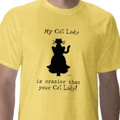"""Crazy Cat Lady shirt is actually for the husband of a lady who loves cats.  It declares, """"My Cat Lady is crazier than your cat lady!"""" and shows cat sitting atop lady's head (in silhouette).  Good Fathers Day gift for man who puts up with his wife's love of cats. #cat #felines #funny #humor $22.95  See more funny shirts at my Zazzle shop."""