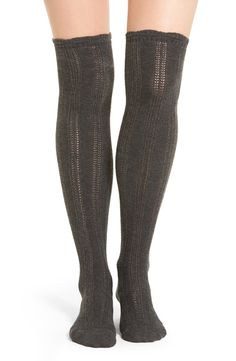 Delicate pointelle stripes lend a feminine touch to these soft, stretchy over-the-knee socks.