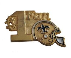 """New Orleans SAINTS Helmet NFL vintage enamel pin button football NOLA Number One Fan by VintageTrafficUSA  14.00 USD  A vintage Saints pin! Lightly used condition. Measures: approx 1"""" 20 years old hard to find vintage high-quality cloisonne lapel/pin. Beautiful die struck metal pin with colored glass enamel filling. Add inspiration to your handbag tie jacket backpack hat or wall. Have some individuality = some flair! -------------------------------------------- SECOND ITEM SHIPS FREE IN…"""
