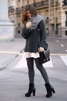 Grey sweater and tights, nude skirt, black booties.
