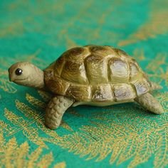 Little OOAK tortoise sculpture. Check out my FB page to see more - you can find a link in my profile! #folksy #art #handmade #custommade #tortoise #fimo #etsy #notonthehighstreet #handmadeisbetter #sculpey #polymerclay #petportrait #premo #ooak #handsculpted #handmadegifts #handmadewithlove #craft #crafts #tortoise #miniature #figurine #ornaments #gift #sculpture #sculpting #clay #tortoiseshell