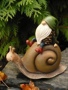 Garden Gnome Riding on a Snail Figurine. Garden Gnome Riding on a Snail Figurine. Clay Projects, Clay Crafts, Twig Crafts, Fairy Land, Fairy Tales, Gnome Village, Gnome House, Gnome Door, Elves And Fairies