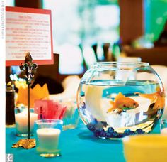 I really wanted to do this on all the tables at my wedding reception, but I wouldn't know what to do with all the fish after! I don't think people would be able to bring them back across the border. Goldfish Centerpiece, Fishbowl Centerpiece, Non Floral Centerpieces, Beach Wedding Centerpieces, Wedding Table, Wedding Favors, Bowl Centerpieces, Party Favors, Centrepiece Ideas