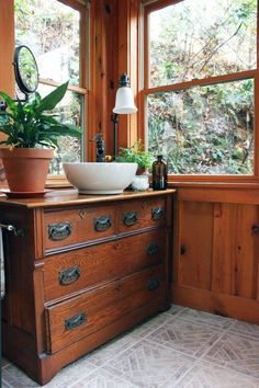 this vintage dresser with hardware is charming!