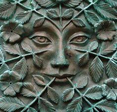green man -- I DON'T THINK THIS FACE IS A MAN'S. I THINK IT IS A WOMAN'S