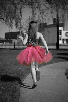 Emphasis; everything around the tutu is black and white; the tutu is the main focal point