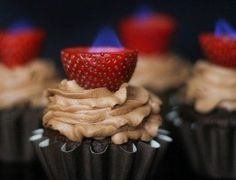 mmmm... flaming strawberries on top of cupcakes.  My mom used to set sugar cubes on fire on top of desserts.  :)