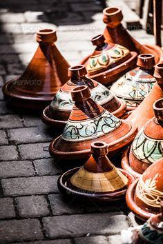 Selection of very colorful Moroccan tajines (traditional casserole dishes) ...  africa, arabic, artisan, bargain, bazaar, berber, bright, buy, casserole, ceramic, cheerful, clay, colorful, cook, cooking, cookware, cuisine, decorative, dish, eat, ethnic, exotic, food, handicraft, handmade, islam, islamic, market, marrakech, marrakesh, meal, medina, moroccan, morocco, muslim, ornament, ovenware, pattern, pile, plate, pot, pottery, safi, sale, shop, souk, store, tagine, tajine, traditional