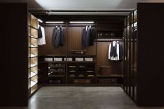 Porro factory showroom - Cantu Italy 2013. 'STORAGE' closet systems by Piero Lissoni, custom built by hand at the factory to meet any criteria. Outfitted with materials, details and accessories for the most discriminating of clients. Engineered by Lissoni and Porro for ease of use and silent function. Modern design, yet devoid of any hint of 'trend' - classic modern, chic and truly luxurious.