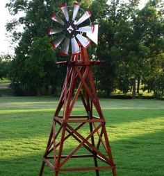 """This windmill would look great in your yard, along your driveway or on your acreage. This unit looks great and has red tipped blades for that old-time traditional look.    Un-assembled windmill comes complete with the tower and head assembly. The fan diameter is 30"""" and the unit is 10' tall."""