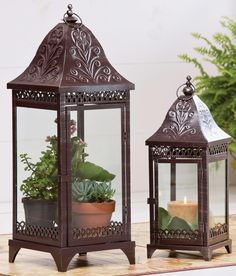 To protect plants!   Set of 2 Bronze Metal Candle Lanterns -