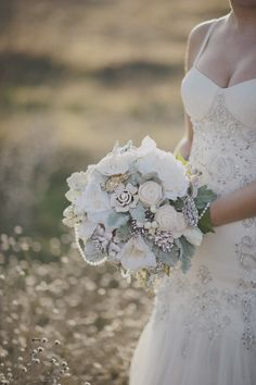 stunning bouquet!      Shannon Cosgrove-Rivas of Flourish recreated Jillian's wedding bouquet for her using the brooches and pearls from her original bouquet and paired them with wooden and silk flowers to create the bouquet Jillian used for the shoot.