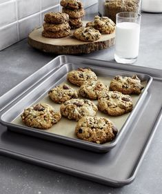 These nested baking sheets in three sizes are crafted of rust- and warp-proof stainless steel with a deep rimmed design and integrated handles. Cookie sheets heat up quickly and evenly while the easy-clean nonstick finish assures clean release of foods. Brushing a very thin layer of butter onto the interior of the pan prior to each use guarantees a perfect release while promoting even browning, good flavor and smooth, tightly sealed crusts.