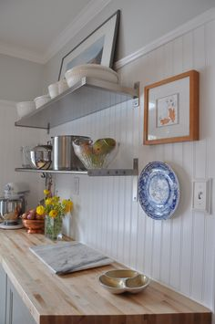 Beadboard backsplash...love that it doesn't look country and dig the idea of taking it high on the wall...