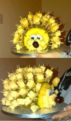 Cheese and Pineapple Hedgehog with googly eyes and a cherry for its nose.