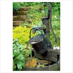 """Close up of old water pump water feature - 28A Braces Lane, Bromsgrove, Worcestershire"