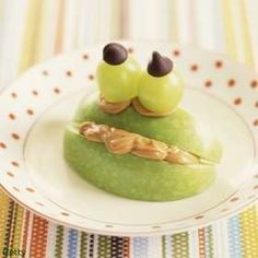 Play with your food! Apple slices + peanut butter + grapes = frog faces.