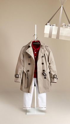 Boys Burberry cotton twill trench coat with Burberry polo and white Burberry pants