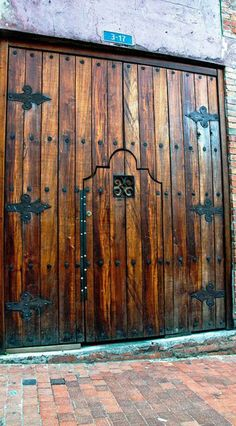 Puertas Door within a door Entrance Doors, Doorway, Garage Doors, Door Entryway, Cool Doors, Unique Doors, When One Door Closes, Rustic Doors, Door Knockers