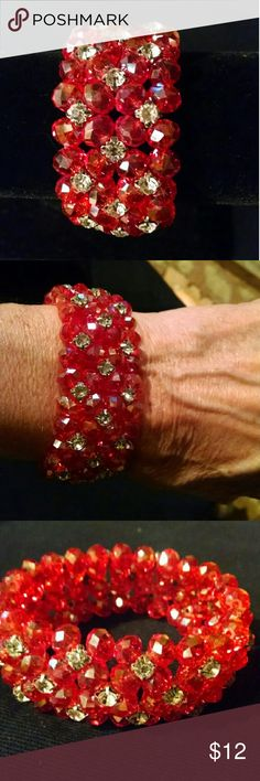 Red beaded stretch bracelet Red beaded stretch bracelet.  Brand new.. Never worn.  Comes in little red gift bag Jewelry Bracelets