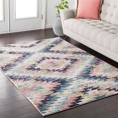 Bring wow-worthy style to your floors with this distinctive area rug, crafted from polypropylene and showcasing a muted color palette. Its geometric details add a pop of pattern to your decor while its multicolor hue is perfect set against a hardwood floor for a contrasting look. Play up this piece's boho inspiration by adding it to an eclectic living room ensemble alongside a streamlined sofa and matching mid-century inspired arm chairs. Dress up nearby walls with abstract canvas prints ...