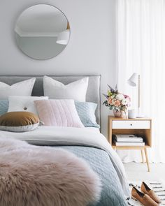 Love the pillows, bedside table (from Adairs), and flowers.