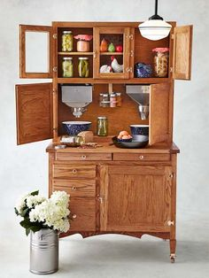 Hoosier Cabinet: A symbol of modernity in the 1920s, these pieces were prized for built-in conveniences: metal dispensing bins for flour and sugar; spice racks; canisters; and more. We built this beauty from a kit via @vandykesonline | Photo: Yunhee Kim