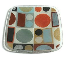 Peggy Karr Handcrafted Art Glass Metro Plate, Square, 8-Inch by Peggy Karr Glass. $34.95. Handmade in the USA. Hand-crafted art glass plate approximately 8-inch square; decorative, functional, and collectible. Metro pattern - retro-modern grid of dots and squares in a neutral pallet. Colored enamel pigments hand-applied and fused between layers of recycled glass; each piece has a unique character of surface texture and bubbles. 100-Percent non-toxic and food-saf...