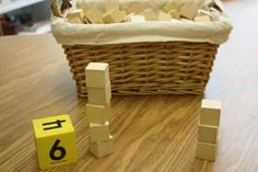 block building game. Roll the dice and make a tower with the number of blocks that appears on the dice.