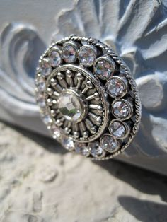 Working on cabinet knobs. DeRosa out of Toronto has a great store -- I found her on Etsy.com. Knobs have beautiful Swarovski crystals on them....Amazing Round Drawer Knob cabinet pull with Swarovski by DaRosa, $8.25